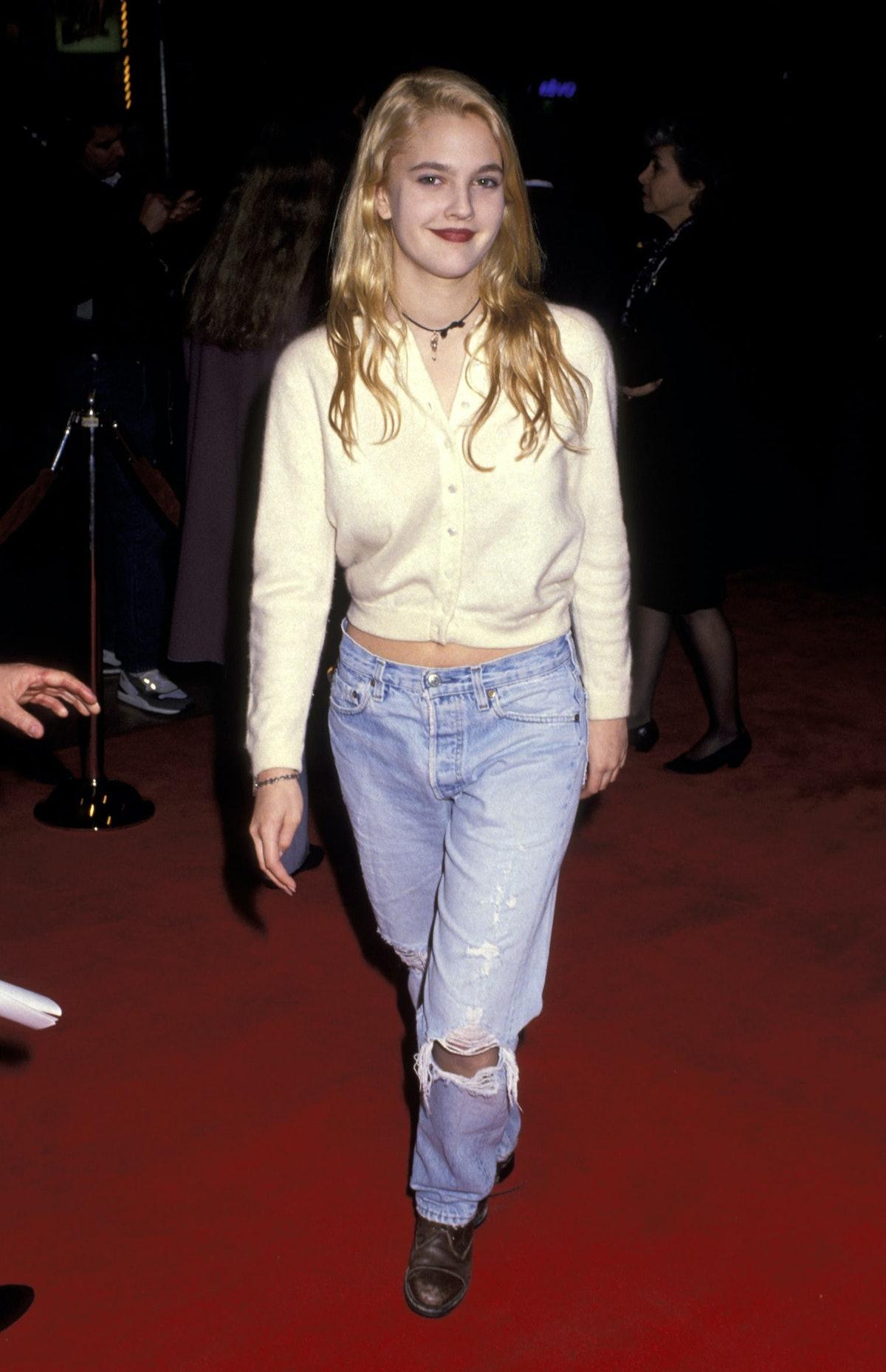 Drew Barrymore wearing jeans in the '90s