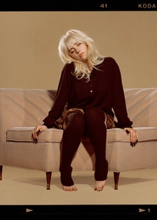 Billie Eilish sitting.