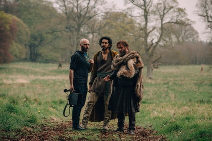 David Lowery, Dev Patel, and Joel Edgerton on set of The Green Knight. Courtesy of A24.