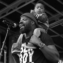 Shawn William performs with his son.
