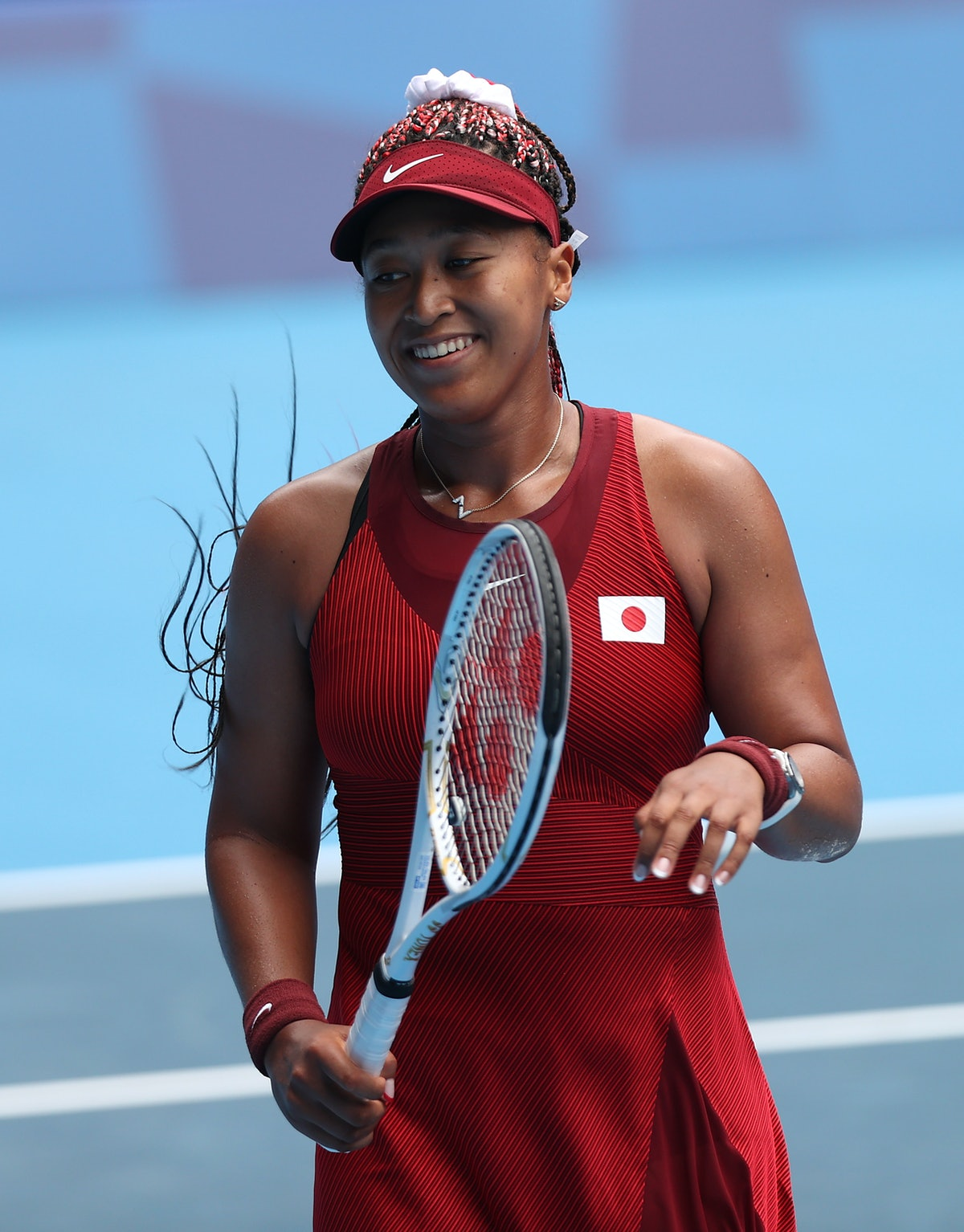 Naomi Osaka of Team Japan prepares to receive serve during her Women's Singles Second Round match ag...