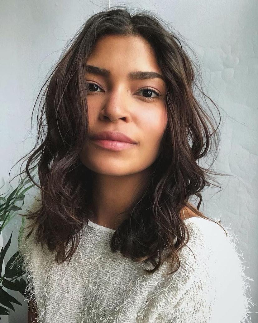 Woman with wavy haircut