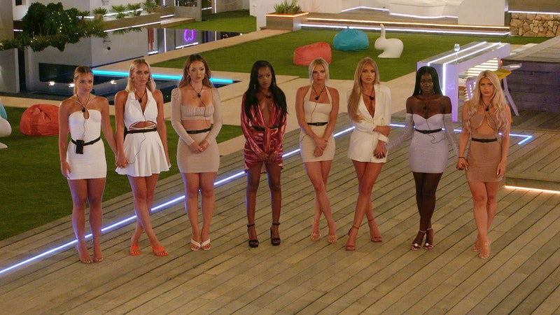 Love Island's women contestants stand in a row at the recoupling