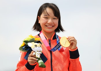Momiji Nishiya of Team Japan poses with her gold medal during the Women's Street Final medal ceremon...
