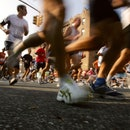 : Runners make their way through a Brooklyn neighborhood during the New York City Marathon November ...