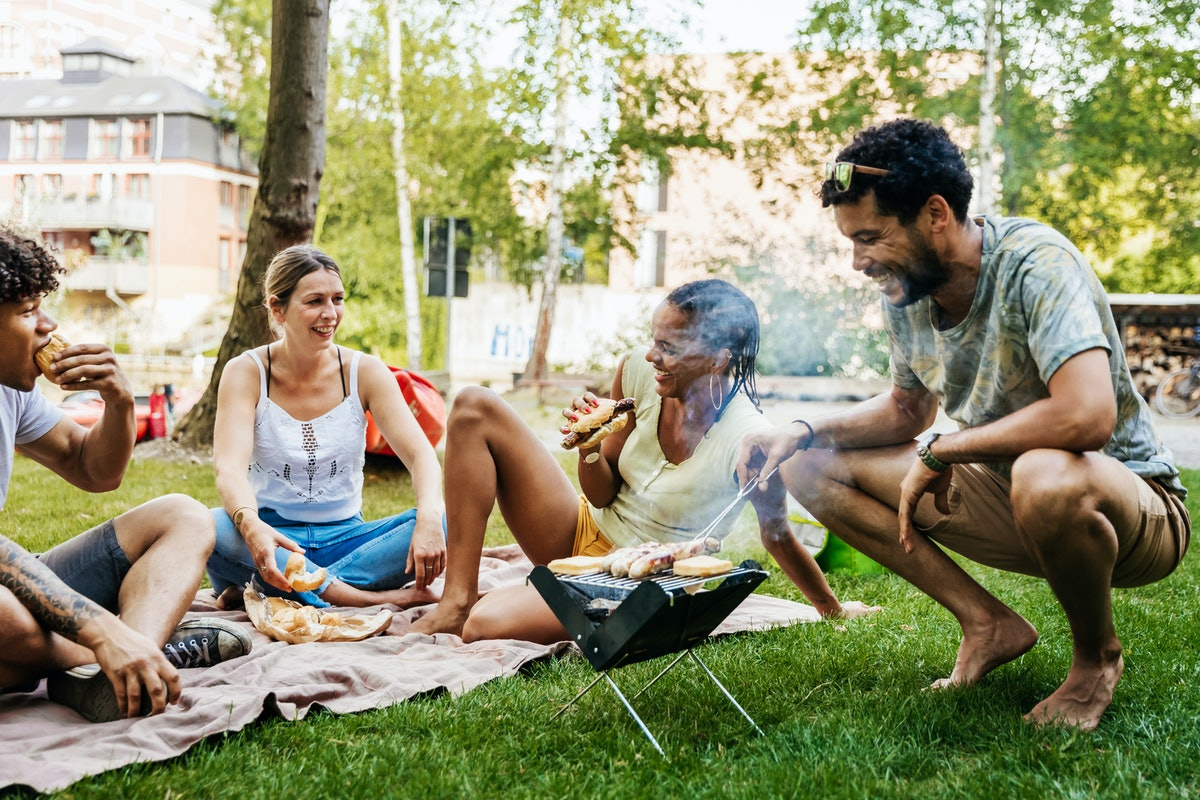 Young friends having a backyard barbecue, in need of bbq captions for Instagram.