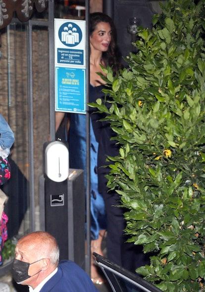 Amal Clooney in a blue slip dress.