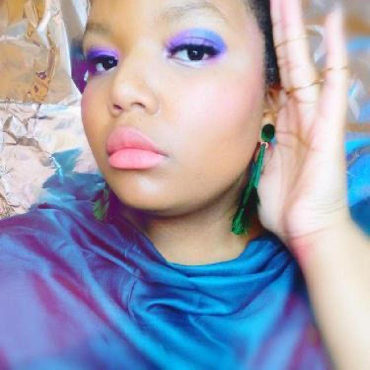 Emeralf Elitou in a gorgeous, full-glam, purple eyeshadow makeup look
