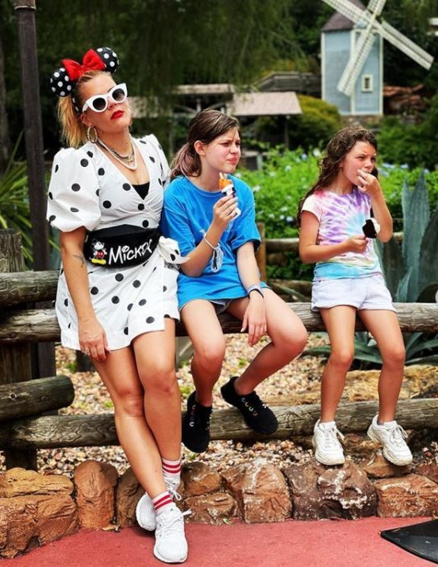 Busy Philipps  and her daughters at  EPCOT during a family vacation to Walt Disney World Resort in L...
