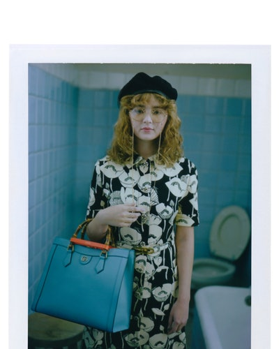 Model carries Gucci's Diana bag from the brand's Diana line.
