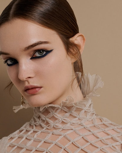 Model in full hair and makeup backstage at Dior Haute Couture A/W '21
