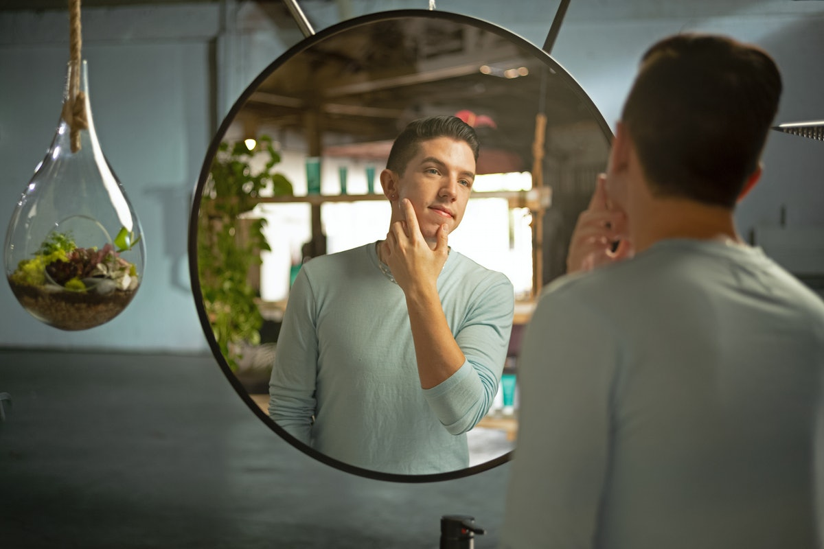 Skin care influencer Hyram Yarbro (Skincare by Hyram) looks in the mirror in a promotional image for...