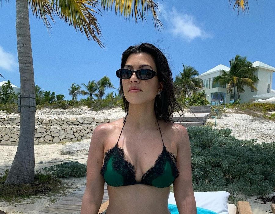 Kourtney Kardashian posts a swimsuit photo to Instagram.