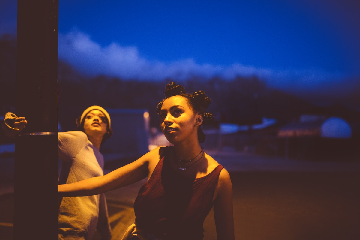 Young women looking up at the night sky during the new moon, wondering what it means.