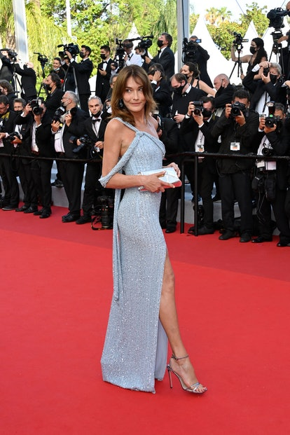 """French-Italian model and musician Carla Bruni arrives for the opening ceremony and the screening of the film """"Annette"""" at the 74th edition of the Cannes Film Festival in Cannes, southern France, on July 6, 2021."""