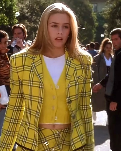 Alicia Silverstone as Cher Horowitz in her iconic yellow plaid outfit in Clueless.