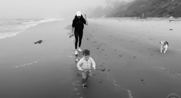Meghan Markle with Archie on the beach.