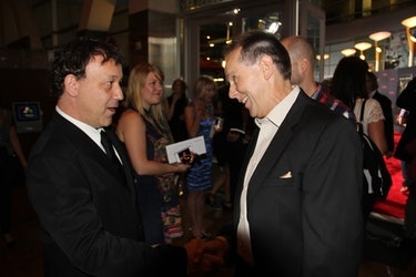 The Possession producer Sam Raimi greets Haxton at the film's Hollywood premiere, Aug. 30, 2012.
