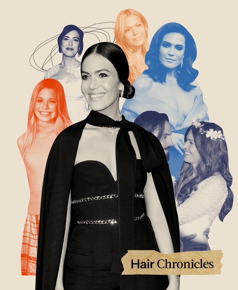 Mandy Moore tells Bustle about her most memorable hairstyles throughout the years, from the ones she'd wear again to those she completely regrets.