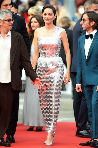 """Director Leos Carax, Marion Cotillard and Simon Helberg attend the """"Annette"""" screening and opening ceremony during the 74th annual Cannes Film Festival on July 06, 2021 in Cannes, France."""