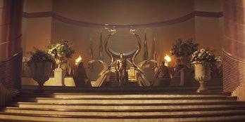 Loki sits on a gold throne in Loki.