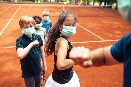 How Does the Delta Variant Affect Kids Like the Ones Seen Here Wearing Masks