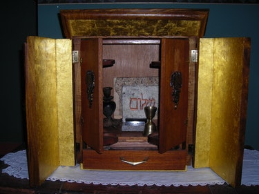 The opened Dybbuk Box is housed in an acacia-wood ark lined with gold leaf, which Jason Haxton built...