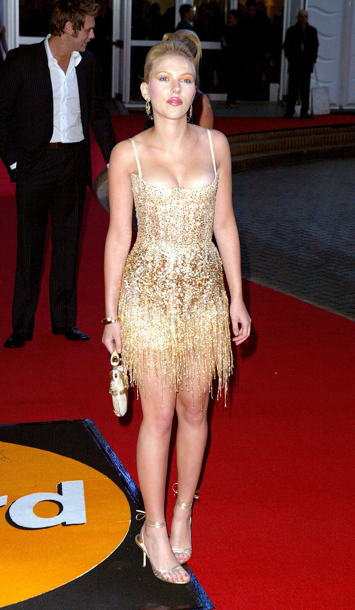 ScarJo in gold dress.