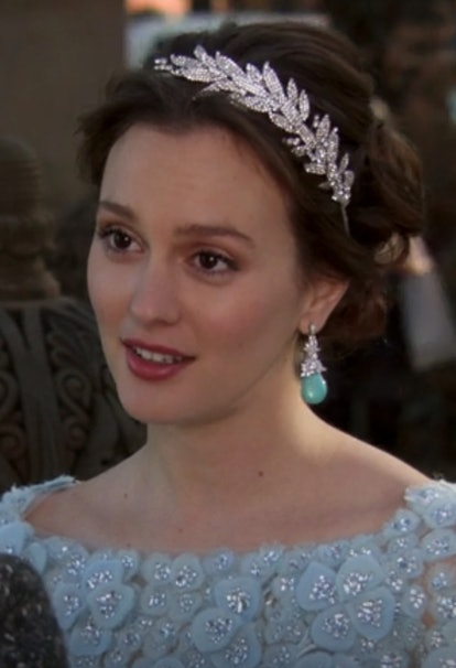 To match the embellished long-sleeve Elie Saab gown, Blair's wedding hair is styled in a low chignon and adorned with a crystal leaf headband. It was classy, elegant, poised —  just how people will always remember the reigning queen of the Upper East Side.