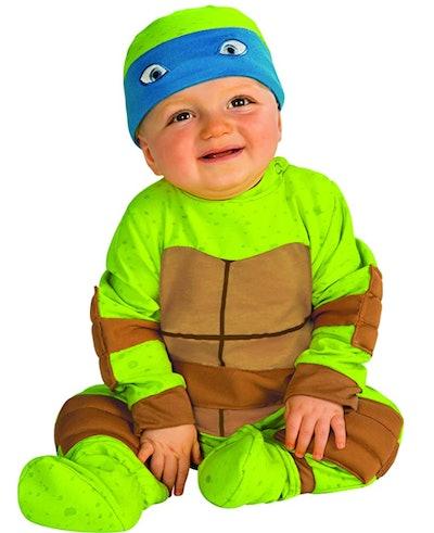 baby dressed in Ninja Turtles costume for Halloween