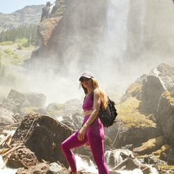 Hiking Bridal Veil Falls in Telluride, CO, wearing a FP Movement workout set, Danner shoes, and Topo...