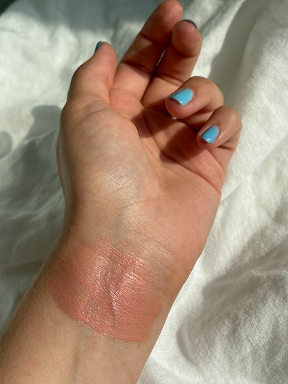 a swatch of the product on Isabella's wrist
