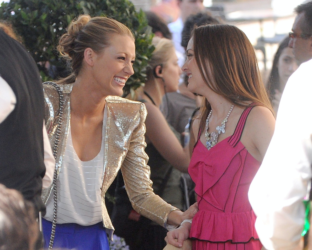 Blake Lively and Leighton Meester as Serena and Blair, laughing on the set of the original 'Gossip Girl'.