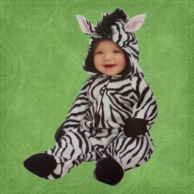toddler in a homemade zebra costume for Halloween