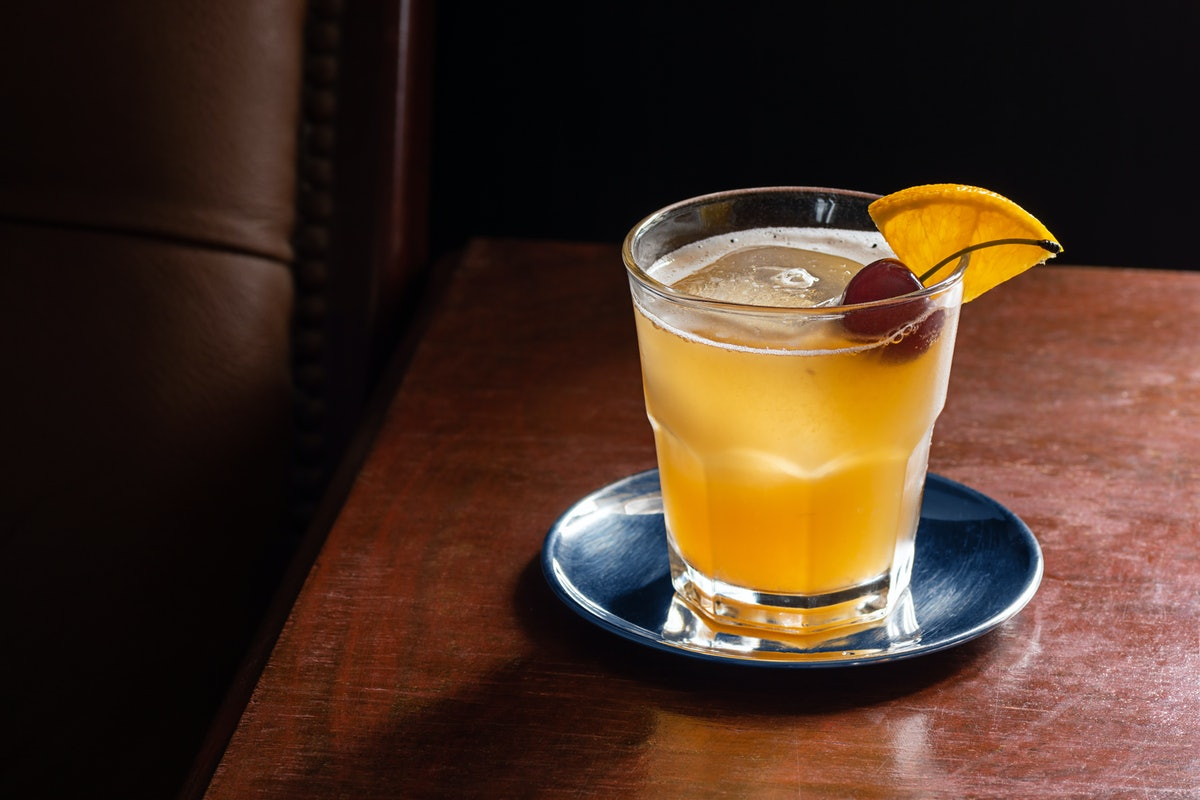 An amaretto sour is a simple, three ingredient cocktail you can make at home.