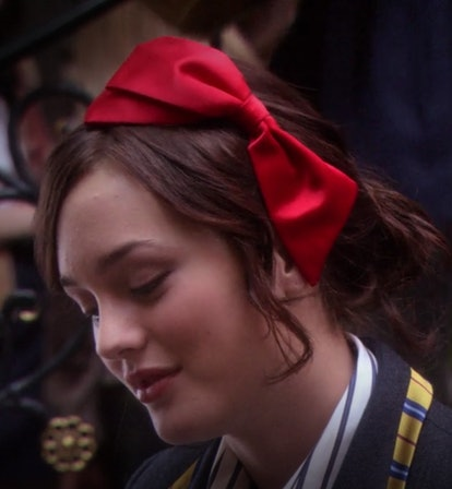 Blair Waldorf used this moment to prove that huge bows are, in fact, high-fashion, wearing a bright red headband that was sophisticated and bold.