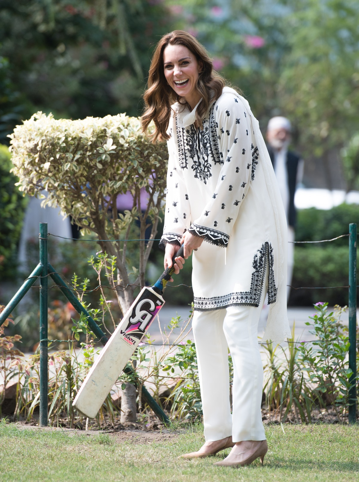 Catherine, Duchess of Cambridge takes part in a game of cricket as she visits SOS Children's Village...
