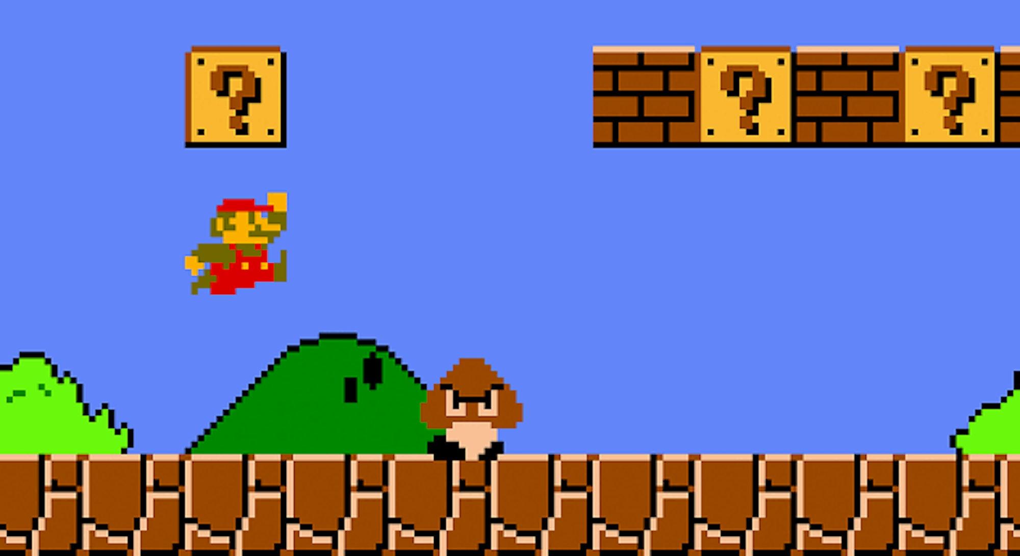 Mario jumping over goomba in Super Mario Bros.