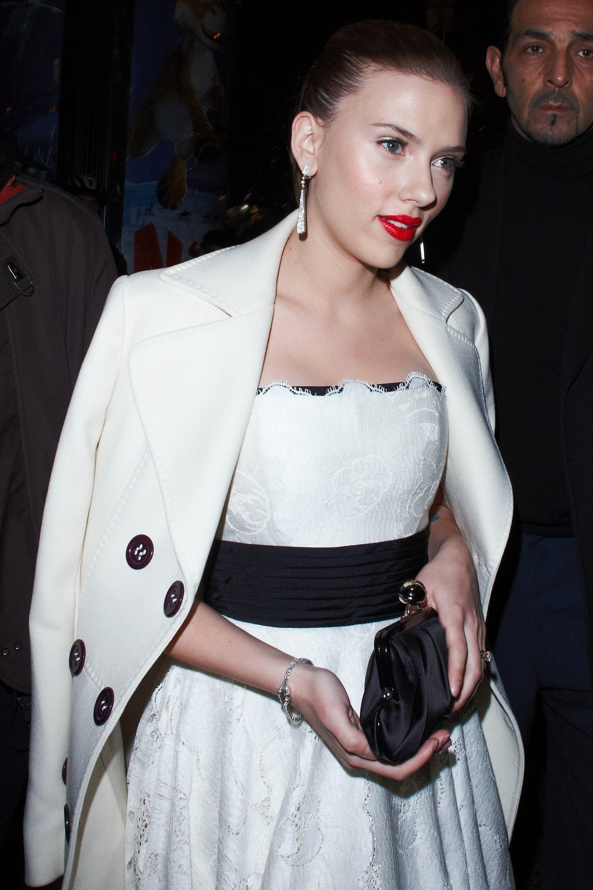 Scarlett in white coat.