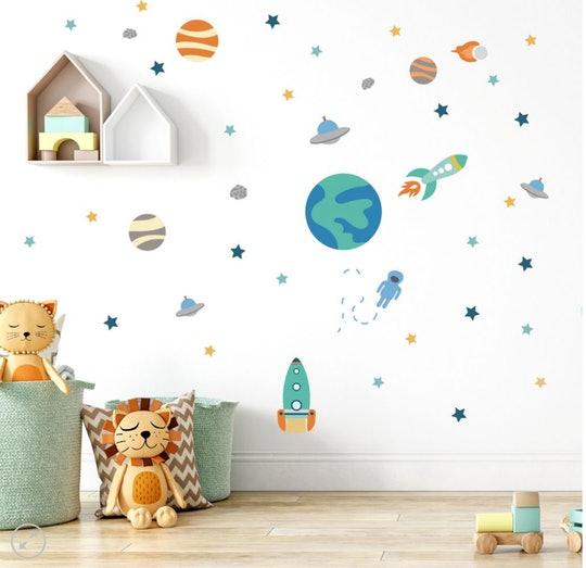 space-themed wall decals on nursery walls