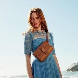 Model wearing Senreve belt bag.