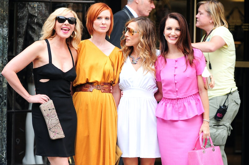 """Kim Cattrall, Cynthia Nixon, Sarah Jessica Parker, and Kristen Davis pose for photos on location at the """"Sex And The City 2"""" film set at Bergdorf Goodman on September 09, 2009 in New York City."""