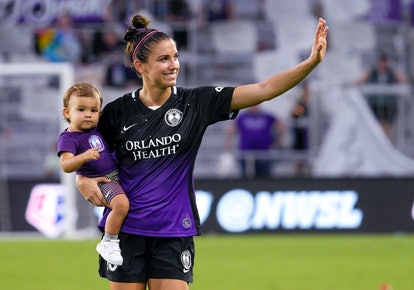 Orlando Pride forward Alex Morgan (13) and her daughter Charlie after the NWSL soccer match between the Orlando Pride and the NY/NJ Gotham FC on June 20, 2021 at Explorer Stadium in Orlando, FL.
