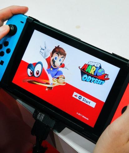 Nintendo Switch running Super Mario Odyssey. Gaming. Video games. Hardware.
