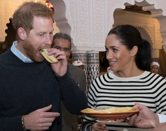 Prince Harry and Meghan Duchess of Sussex, try pancakes at a cooking school demonstration in Rabat.