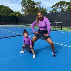 Serena Williams and her daughter Olympia wear matching tennis outfits.
