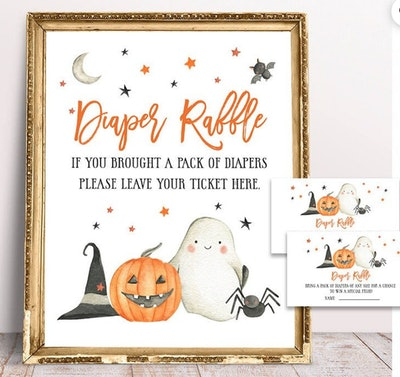 """Close up image of """"Diaper Raffle"""" sign and cards featuring Halloween decor"""