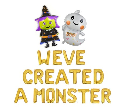 """One witch and one ghost balloon, letter balloons spelling out """"We Created A Monster"""""""
