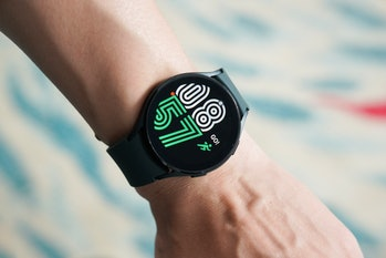 Samsung Galaxy Watch 4 with fitness watch face.