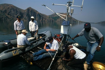 Researchers set up monitoring equipment at Africa's Lake Nyos that will sound an alarm if carbon dio...